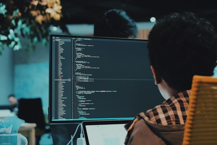 person reading code on computer